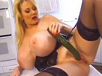 Big titted milf plays with cucumber