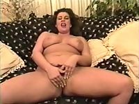 Dark-haired chubby chick gets kinky dildo fucking her cock starved pussy