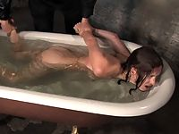 Sexy young woman is tied up fucked and water tortured