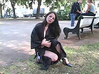 Cute flasher throws her coat off in the city park