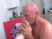 Smooth brunette chick gets heavy foot licking thrill from bald lover.