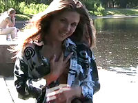 Adorable teen chick unbuttons her shirt in public