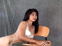 Asian slut bending over to show her tight hole to the camera.