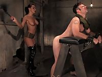 Mistress Sandra Romain interrogates helpless cum eating prisoner