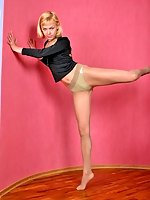 Blonde gymnast girl with long legs in pantyhose