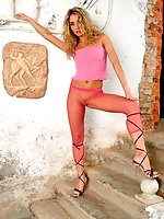 Blonde Sielle in red fishnet pantyhose shows great tits