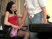 Sweltering brunette seducing eager guy into strap-on fucking on the table