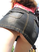 Perverted doll willingly shows naked upskirt in the street