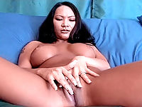 Busty exotic bitch taking in a hard pounding from behind.
