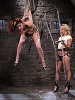 Two girls fuck with strap-ons in mid-air.