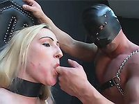 Masked latex slave dude in action