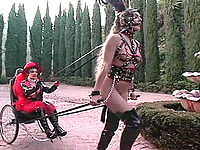 The naked pony mistress leads her leather-bound babe along!