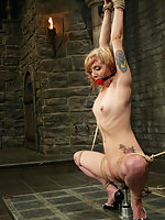 Predicament is shown with a floor mounted dildo and clit-jet