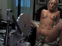 Sexy slender blonde is machine fucked in her tight pussy.