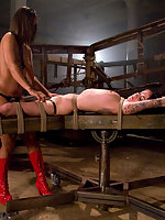lesbian Domination with bondage and strapon sex.