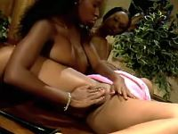 Three ebony lesbians relax on table