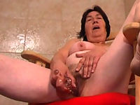 Horny full grandma shags herself with a big dildo