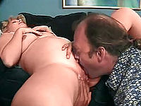 Blonde preggo bending over to fill her shaven pussy.