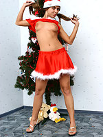 Little stripper posing in a sexy Christmas outfit