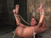 Sexy tan Holly Wellin is tied up tight and forced to cum tickled