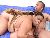 Feisty black fatty deep throating a huge black dick