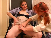 Ponytailed redhead kneeling down to get under the skirt of a wet mature gal