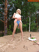 Blonde teen pissing in the beach