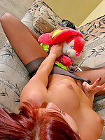 Lusty gal willingly giving her plush toy a glimpse of her pantyhosed crotch