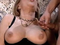 Beautiful milf gets cumshot on tits
