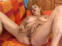 Naked old whore with huge jugs plays with dildo