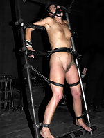 Alexa Von Tess and Sara Faye suffer in cages and severe leather.
