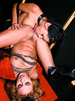 Two lesbians in boots playing with dildos