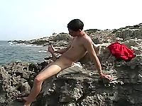Cute young gay masturbates and jizzes by sea