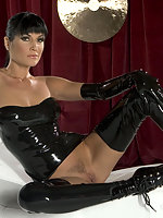 Wild babe in black latex has really long legs